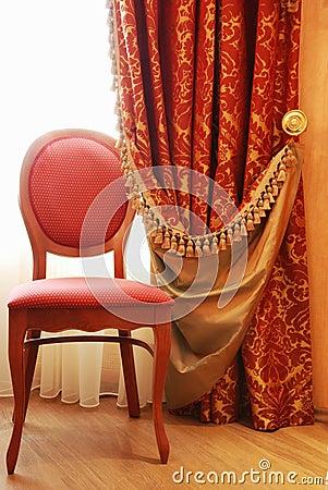 Cadeira antiga da elegância
