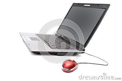 Caderno com rato do computador