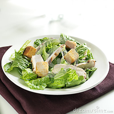 Caesar salad with grilled chicken and copy space