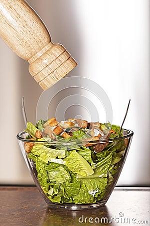 Caesar salad and pepper