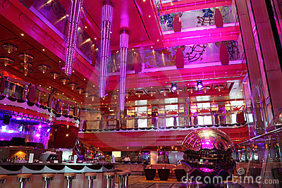 Cafe with bright interior, big chandelier and bar
