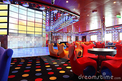 Cafe with bright interior and big screen on wall