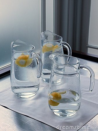 Cafe: glass water jugs with lemon