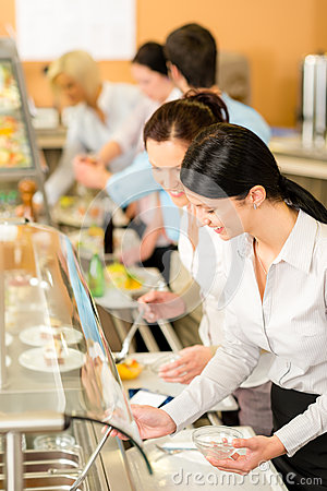 Cafeteria lunch two office woman choose food