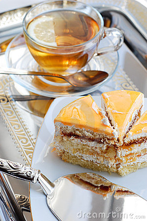 Cake with apricot and tea