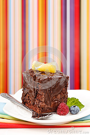 Cake with a chocolate gloss on plate