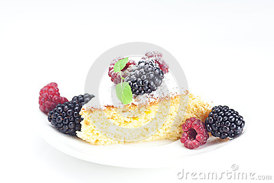 Cake with icing and berries