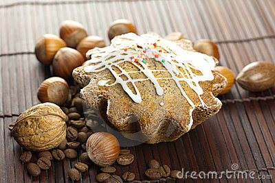 Cake with icing, coffee beans and nuts