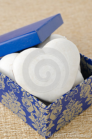 Cake with icing in the form of heart in a gift box, selective fo