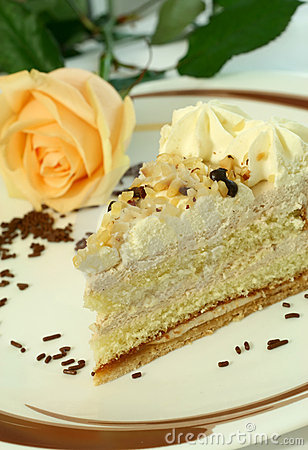Cake with nuts, chocolate, cream and rose