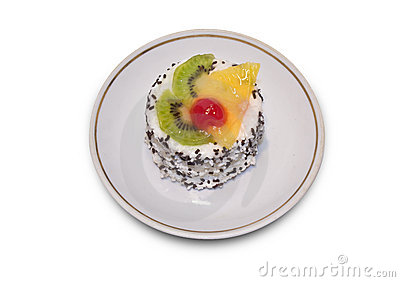 Cake with spinkles and slices of fruit on top.