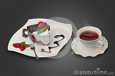 Cake with strawberry and a cup of tea