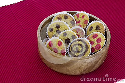 Cakes on a bowl over red towl