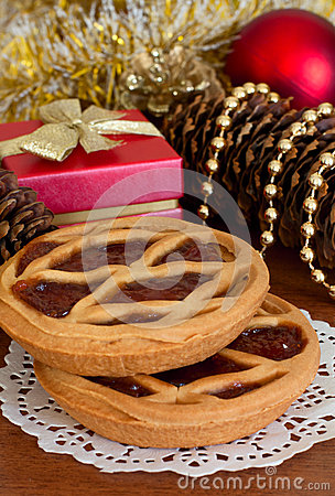 Cakes with jam and Christmas decorations