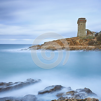 Calafuria Tower landmark on cliff rock and sea. Tuscany, Italy. Long exposure photography.