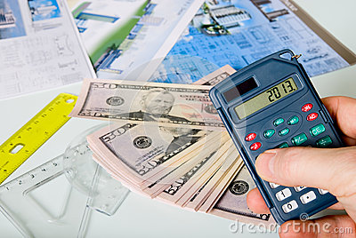 Calculator on a blurred background of the project and dollars