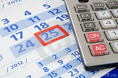 Calculator on calendar background