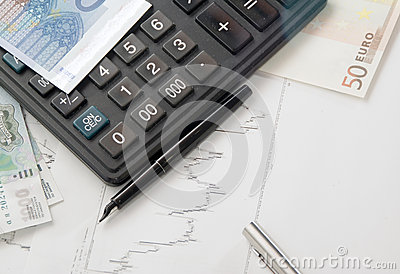 Calculator, chart and the money