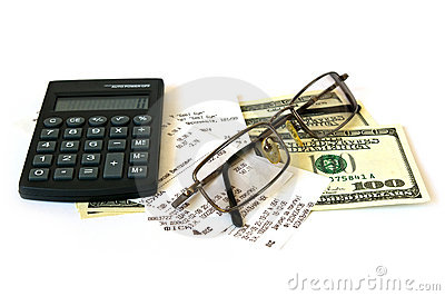 Calculator and dollars on white background