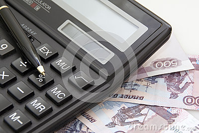 Calculator, money and black pen