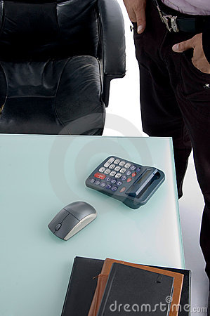 Calculator and mouse on desk
