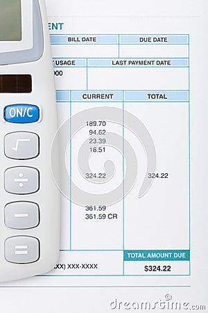 Calculator next to a bill