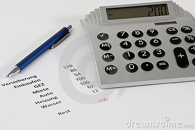 Calculator and a pen along with a negative budget