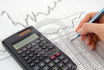 Calculator and pen on a business background
