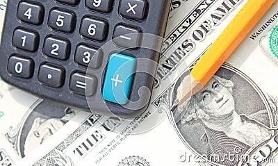 Calculator, pen at dollars
