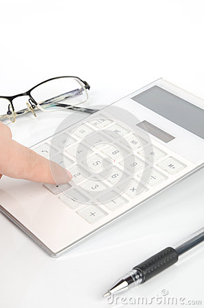 Calculator And Pen With Glasses Royalty Free Stock Image - Image: 25354126