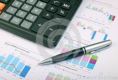 Calculator, pen over annual report