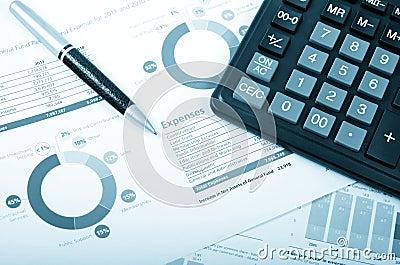 Calculator, pen over annual report