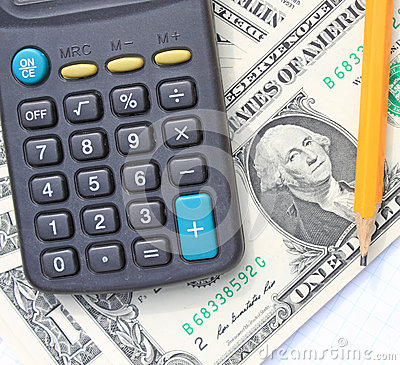 Calculator, pen and pad at dollars