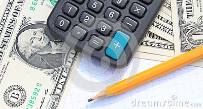 Calculator, pen and pad at dollars