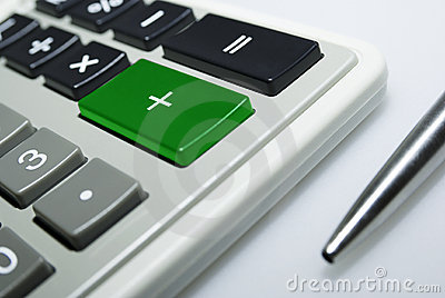 Calculator and pen on white background.