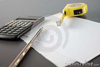 Calculator pencil and meter tape measure