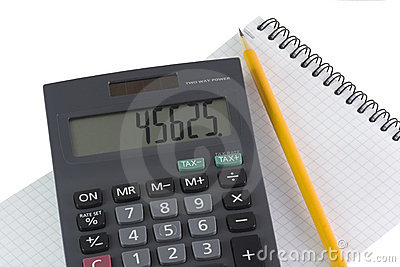 Calculator and pencil on notebook