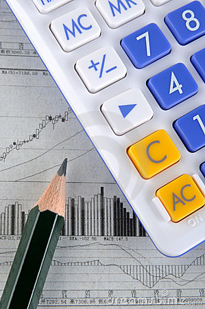 Calculator, pencil and stock chart