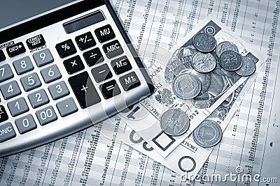 Calculator, polish money and newspaper