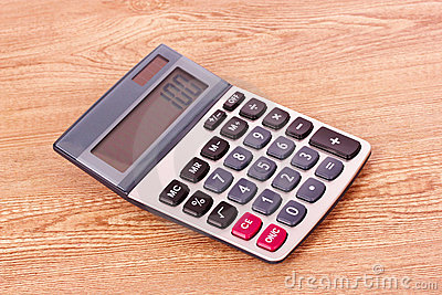 Calculator on wooden background