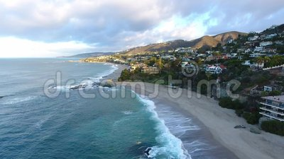 California, United States, Aerial view of beach houses along Pacific Coast in California. Real estate during sunset. California, United States. Aerial view of stock footage