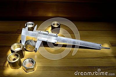 Caliper and brass nuts