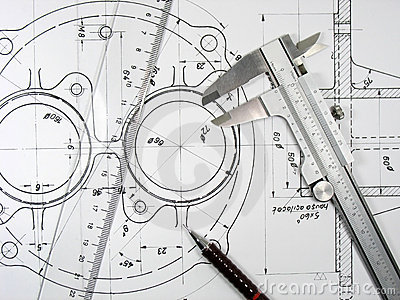 Caliper, ruler and pencil on technical drawings.
