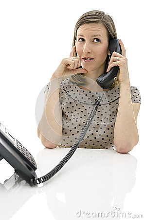 Call center employee on a telephone