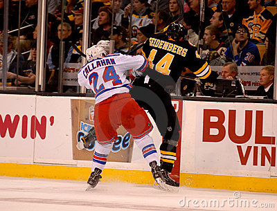 Callahan checks Seidenber, Rangers v. Bruins NHL Editorial Photo