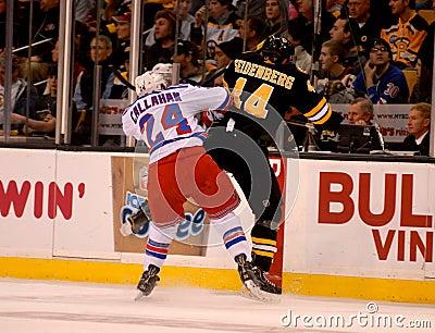 Callahan checks Seidenber, Rangers v. Bruins NHL Editorial Photo