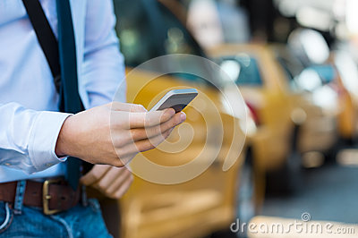 Calling a taxi with phone Stock Photo