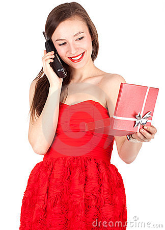 Calling young woman keeping red present box