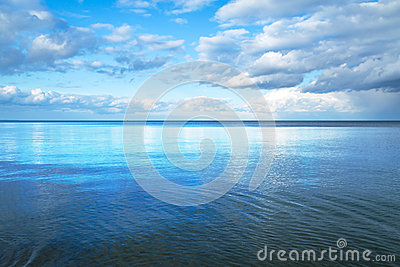Calm Baltic sea with blue sky