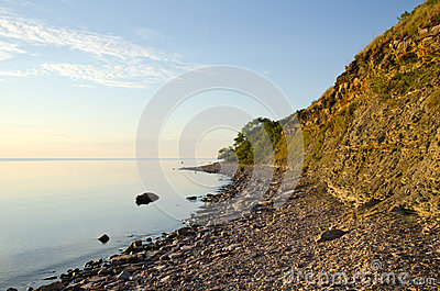 Calm and bright coastline with cliff steep